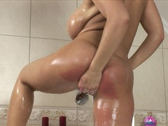 Scorching Laura Lion bathing herself in a tub and starts to get horny