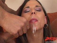 Pretty babe Simony Diamond receives a rich load of jizz on her mouth