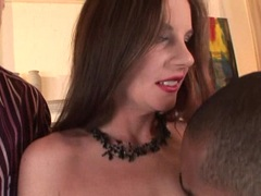Brunette babe Evelyn Foxy kneels on two cocks and sucks it alternately