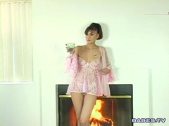 Asian babe Jade Hsu starts to get horny hot on the fireplace