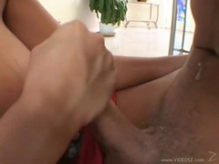 Busty pornstar Gianna Michaels kneels herself on a cock and gives it a wild blow