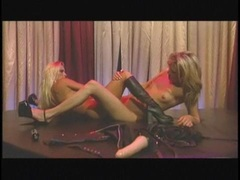 Lesbian pornstar Holly Halston shares a toy with a lusty girlfriend in the twat