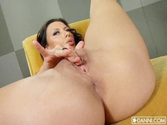 Lusty pornstar Rachel Starr rubbing her pink slices on the couch until she cums