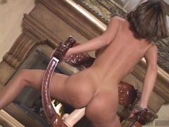 Lusty nymph Crissy Moran sitting her slippery twat on a huge toy cock