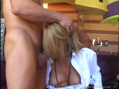 Blonde sweetie Delilah Stone takes two cocks in her mouth alternately