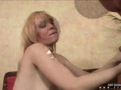 Horny hot Annette Schwarz gives her stud a wild messy blow on the cock
