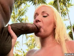 Blonde chick Alexia Sky stuffs her tight mouth with a monstrous black cock
