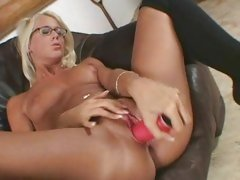 Sexy nerdy Dorina fills her sweet snatch with a hard toy on the couch