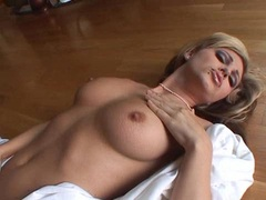 Glamourous Jesse Capelli caresses hersel on the floor and gets more hot