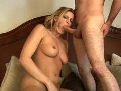 Milf Darryl Hanah works her juicy slot with rubber dongs while sucking real one