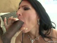 Milf honey Kendra Secrets feeds her hungry mouth with a monstrous black cock