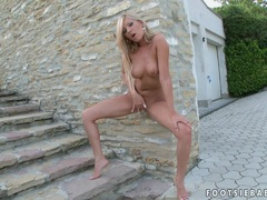Blonde chick Donna Bell gets too hot to handle naked and horny outdoor