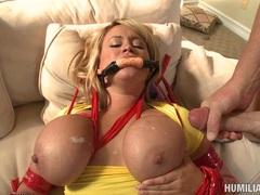 Sex slaved Brandy Taylor gets her meaty chest bags jizzed after a hot wild fuck