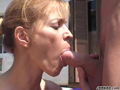 Sensually hot milf Nicole Moore stuffs her warm mouth with an awesome hard cock