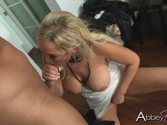 busty babe Abbey Brooks eagerly takes a meaty cock in and out her sweet mouth