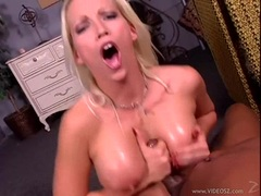 Bitchy babe Nikki Hunter made a cock splash its cum on her meaty round jugs