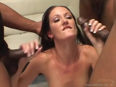 Hailey Young loves to take double black cock deep down her tight throat