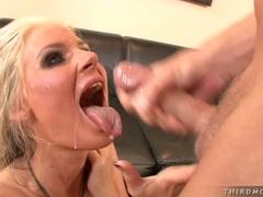 Lusty blonde bitch Phoenix Marie receiving a hot blast of cum on her juicy mouth