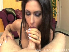 Beautiful and hot Jessica Jaymes sexily fills her mouth with a juicy hard cock