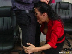 Dark haired whore deliciously fills her juicy mouth with a massive boner