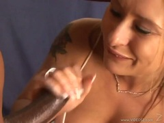 Filthy hot babe Rebecca Steel fills her mouth with a monster cock til she chokes
