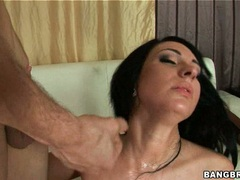 Sensually hot Kitty Bella receives a warm spray of cock juice on her face