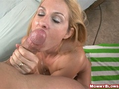 Scorching hot Angela Attison receives a fresh blast of jizz on her lusty mouth