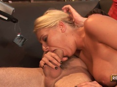 Slutty blonde Riley Evans takes a monstrous white cock in her mouth and loves it