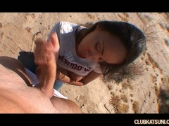 Asian beauty Katsumi sucks on a stiff hard cock in the desert