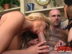Two filthy sluts wrap their juicy moist lips round a huge throbbing stiff prick