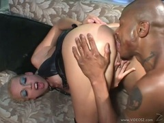 Foxy Nikki Hunter opens her ass and takes in a huge black cock for hot anal