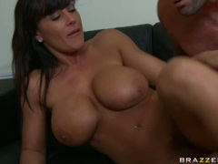 Lisa Ann gets a portion of creamy cock milk sprayed over ner neck