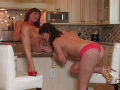 Lusty Desi Foxx rocks her kitchen with a lesbian action with her girlfriend