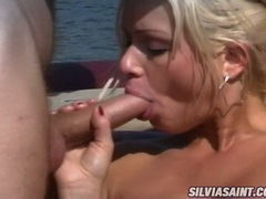 Scorching hot Stacy Silver takes one cock at a time in her slippery hot mouth