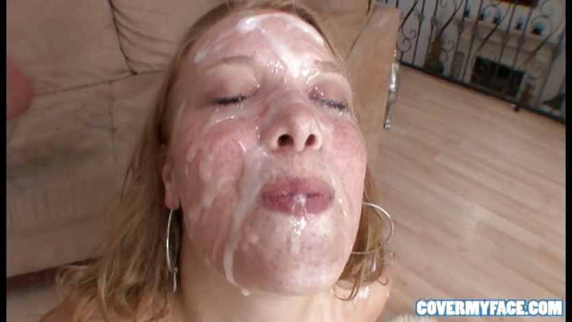 her face was covered in cum