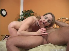 Lusty hot Lori Lust crouches in bed and gives her lover a nice blow on the cock