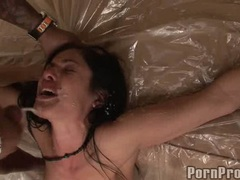 Pornstar Sadie West receives a hot explosion of cum on her sultry hot face