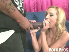 Cock lover Kelly Wells munches a monstrous boner like a yummy sausage