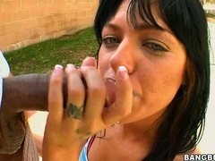 Black haired Sadie West gets her mouth pleasured with a monster boner
