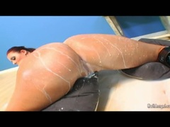 Lusty babe Sophie Dee squirting on her sexy girlfriend for some lesbian action