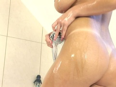 Lusty red haired Ashley Robbins gets too hot to handle in the shower naked