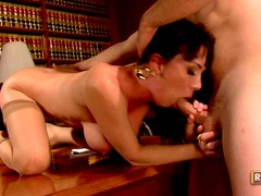 Scorhing momma Rayveness fills her mouth with a man meat sausage