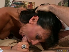 Darked haired whore Lezley Zen fills her mouth with her man's snake like cock