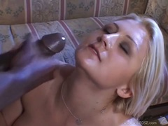 Cum craving honey Stacy Thorn receives a rich load of cock spurt on her face