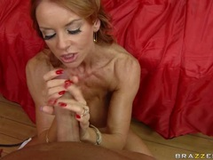 Filthy red haired Janet Mason gets her mouth whacked by a massive bone