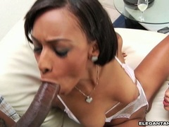 Red haired Angel Cummings fills her mouth with an awesome black boner