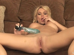 Angie Savage plays her pussy with her blue crystal dildo
