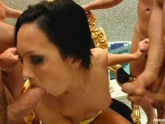 Regina Moon gives a perfect blowjob in a group of hard cocks