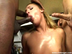Big ass blonde Lauren Pheonix sucking on two big hard pricks