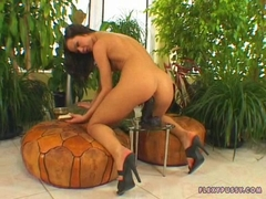 Angelina Crow sits on a big hard rubber toy outdoor
